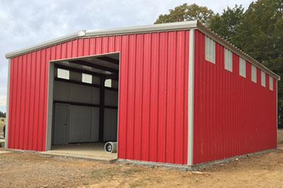 Red Iron Metal Shop garage with large bay door